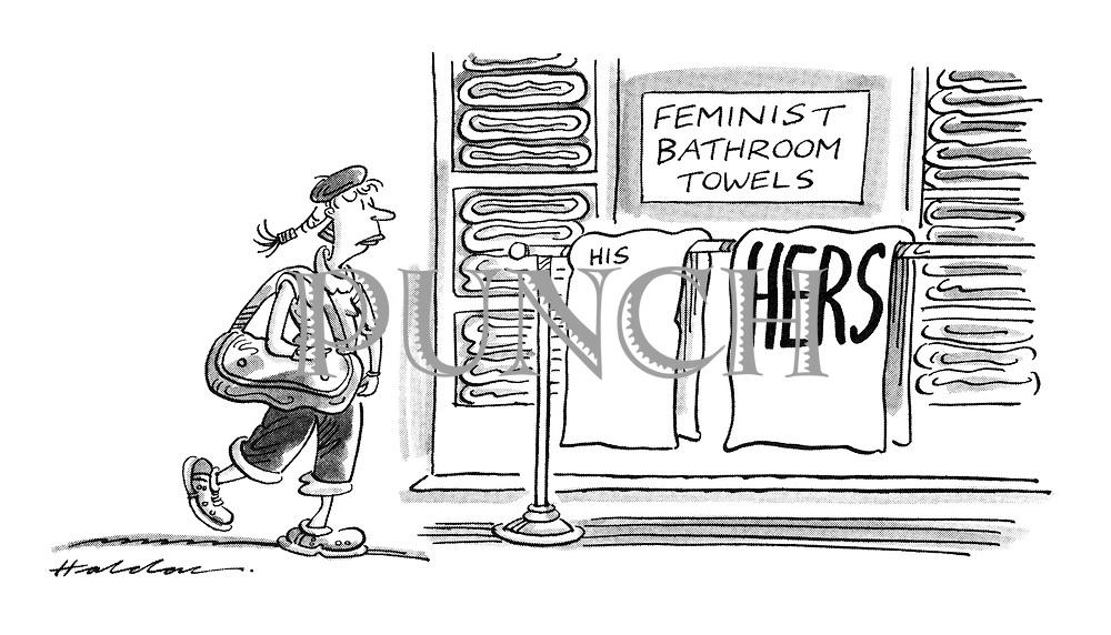(woman in department store coming across display of feminist towels)