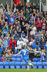 Jon Taylor of Peterborough United celebrates scoring in front of jubilant Posh fans - Mandatory byline: Joe Dent/JMP - 07966 386802 - 03/10/2015 - FOOTBALL - ABAX Stadium - Peterborough, England - Peterborough United v Millwall - Sky Bet League One