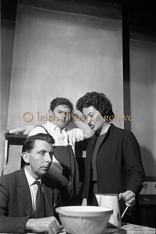 """20/09/1963<br /> 09/20/1963<br /> 20 September 1963<br /> Dublin Drama Festival production of """"Roots"""" at Damer Theatre for Gael Linn.<br /> """"Roots"""" by Arnold Wesker of London translated into Irish by Padraic Ó Gaora was the first production of a Wesker play in Ireland, produced by Seamus Pair Ceir, with sets by Noel O'Brien. Picture shows a scene from the production (l-r): Tadh Ó Muiri (as Mr Bryant); Micheal Ó Ruairc (as Jimmy Beales) and Mairin Crúc (as Mrs Bryant)."""