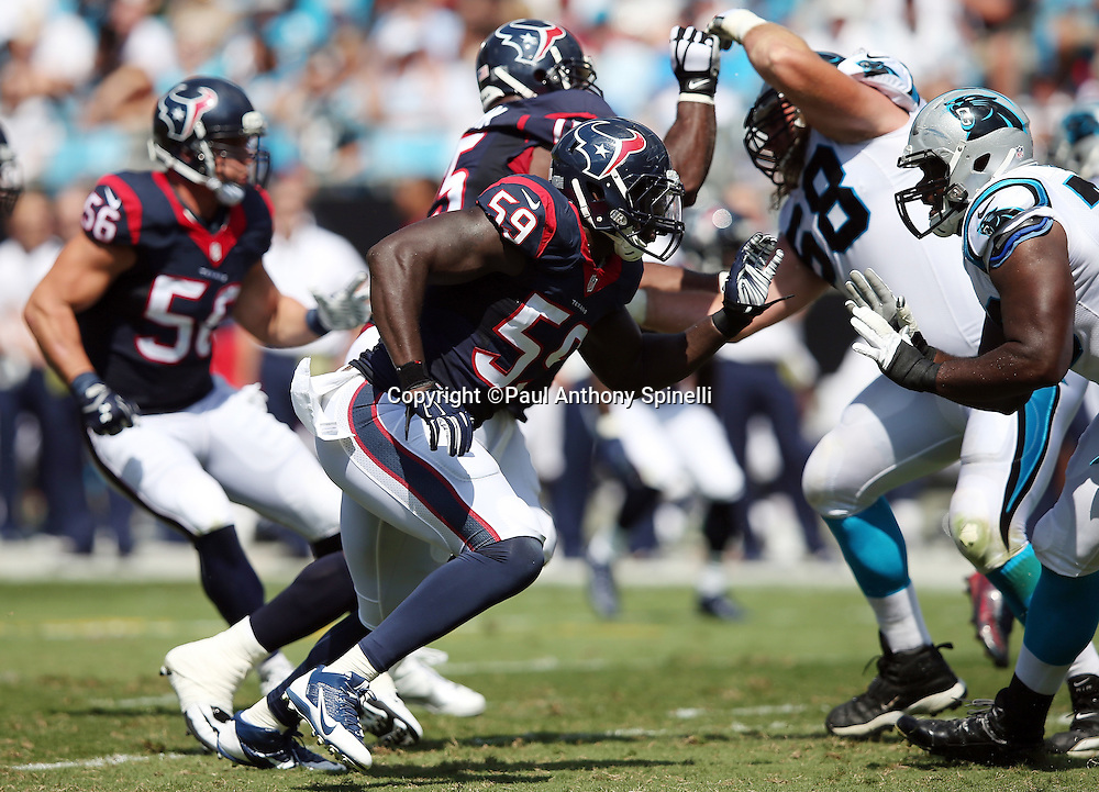 Houston Texans outside linebacker Whitney Mercilus (59) chases the action during the 2015 NFL week 2 regular season football game against the Carolina Panthers on Sunday, Sept. 20, 2015 in Charlotte, N.C. The Panthers won the game 24-17. (©Paul Anthony Spinelli)