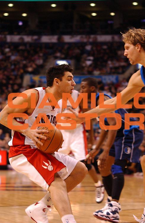 DESCRIZIONE : Toronto Campionato NBA 2007-2008 Toronto Raptors Dallas Mavericks<br /> GIOCATORE : Carlos Delfino<br /> SQUADRA : Toronto Raptors Dallas Mavericks<br /> EVENTO : Campionato NBA 2007-2008 <br /> GARA : Toronto Raptors Dallas Mavericks<br /> DATA : 12/12/2007 <br /> CATEGORIA :<br /> SPORT : Pallacanestro <br /> AUTORE : Agenzia Ciamillo-Castoria/V.Keslassy<br /> Galleria : NBA 2007-2008 <br /> Fotonotizia : Toronto Campionato NBA 2007-2008 Toronto Raptors Dallas Mavericks<br /> Predefinita :