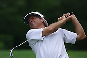 Jun 26, 2006; Gaylord MI; Fred Couples watches his tee shot on the fourth hole during the ING Par-3 Shootout at Treetops Resort in Gaylord Michigan.