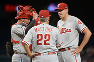 PHOENIX, AZ - JUNE 26:  Andrew Knapp #34 and Nick Pivetta #43 of the Philadelphia Phillies listen to pitching coach Bob McClure #22 in the second inning of the MLB game against the Arizona Diamondbacks at Chase Field on June 26, 2017 in Phoenix, Arizona.  (Photo by Jennifer Stewart/Getty Images)