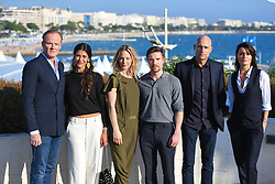 (L-R) Alistair Petrie, Karima McAdams, Lynn Renee, Joe Dempsie, Mark Strong, Anastasia Griffiths pose at the photocall of 'Deep State' during MIPCOM (International Market of Communications Programmes) at Palais des Festivals et des Congres, Cannes<br />