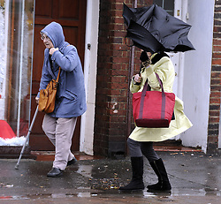 © Licensed to London News Pictures. 03/01/2012.London, UK. Two elderly women battle heavy rain and winds on Pettswood High Street, London on January 3rd, 2012. The Met Office has issued a severe weather warning as heavy rain and 85mph winds battered Britain. Photo credit : Grant Falvey/LNP