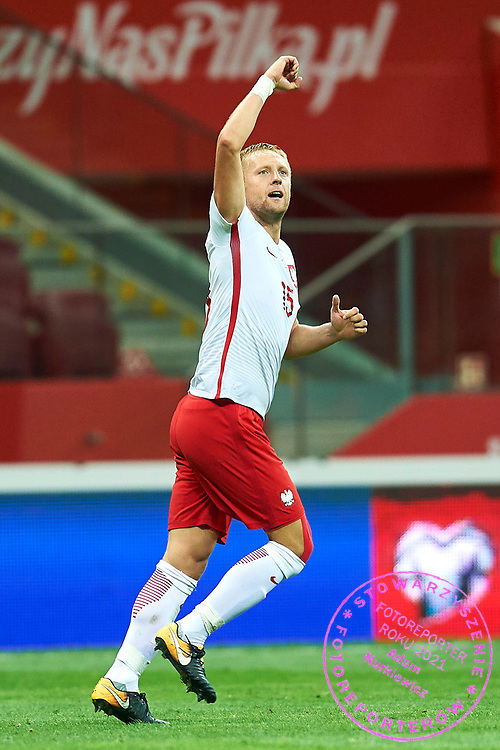Warsaw, Poland - 2017 September 04: Kamil Glik from Poland celebrates after scoring during soccer match Poland v Kazakhstan - FIFA 2018 World Cup Qualifier at PGE National Stadium on September 04, 2017 in Warsaw, Poland.<br /> <br /> Adam Nurkiewicz declares that he has no rights to the image of people at the photographs of his authorship.<br /> <br /> Picture also available in RAW (NEF) or TIFF format on special request.<br /> <br /> Any editorial, commercial or promotional use requires written permission from the author of image.<br /> <br /> Mandatory credit:<br /> Photo by &copy; Adam Nurkiewicz / Mediasport