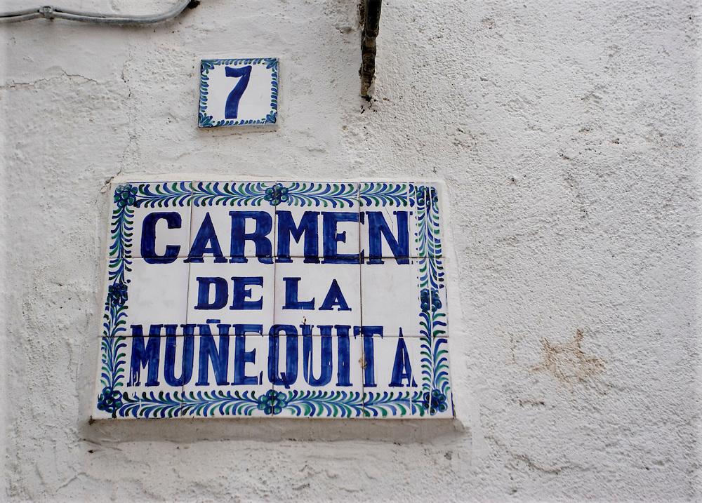 Carmen de la Mu&ntilde;equita street sign in Granada.<br /> <br /> Cartel de la Calle Carmen de la Mu&ntilde;equita en Granada.