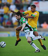 Yeovil - Tuesday, August 11th, 2009: Andrew Walsh of Yeovil and Tom Adeyemi of Norwich City during the Carling Cup 1st Round match at Yeovil. (Pic by Alex Broadway/Focus Images)