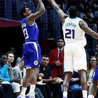 31 December 2017: LA Clippers guard Lou Williams (23) takes a jump shot over Charlotte Hornets guard Treveon Graham (21) during the LA Clippers 106-98 victory over the Charlotte Hornets, at the Staples Center, Los Angeles, California, USA.