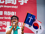 09 JUNE 2018 - SEOUL, SOUTH KOREA: A South Korean Christian sings at a pro-American rally in downtown Seoul. Christianity is the second largest religion in South Korea. Participants said they wanted to thank the US for supporting South Korea and they hope the US will continue to support South Korea. Many were also opposed to ongoing negotiations with North Korea because they don't think Kim Jong-un can be trusted to denuclearize or to not attack South Korea.   PHOTO BY JACK KURTZ