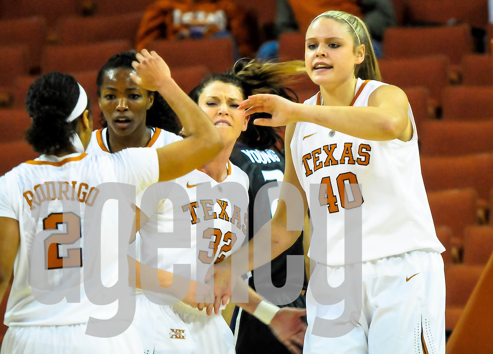 Jan 5th 2014: (40) Kelsy Lang after a made shot and a foul. (2) Celina Rodrigo, (32) Brady Sanders and (3)Nneka Enemkpali congratulate her. UT Lady Horns vs K-Sate Lady Wildcats, Frank Erwin Center, Austin, Texas