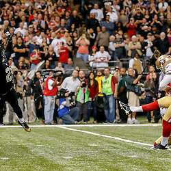 Nov 9, 2014; New Orleans, LA, USA; San Francisco 49ers kicker Phil Dawson (9) kicks the game winning field goal past New Orleans Saints cornerback Patrick Robinson (21) during overtime of a game at Mercedes-Benz Superdome. The 49ers defeated the Saints 27-24 in overtime. Mandatory Credit: Derick E. Hingle-USA TODAY Sports