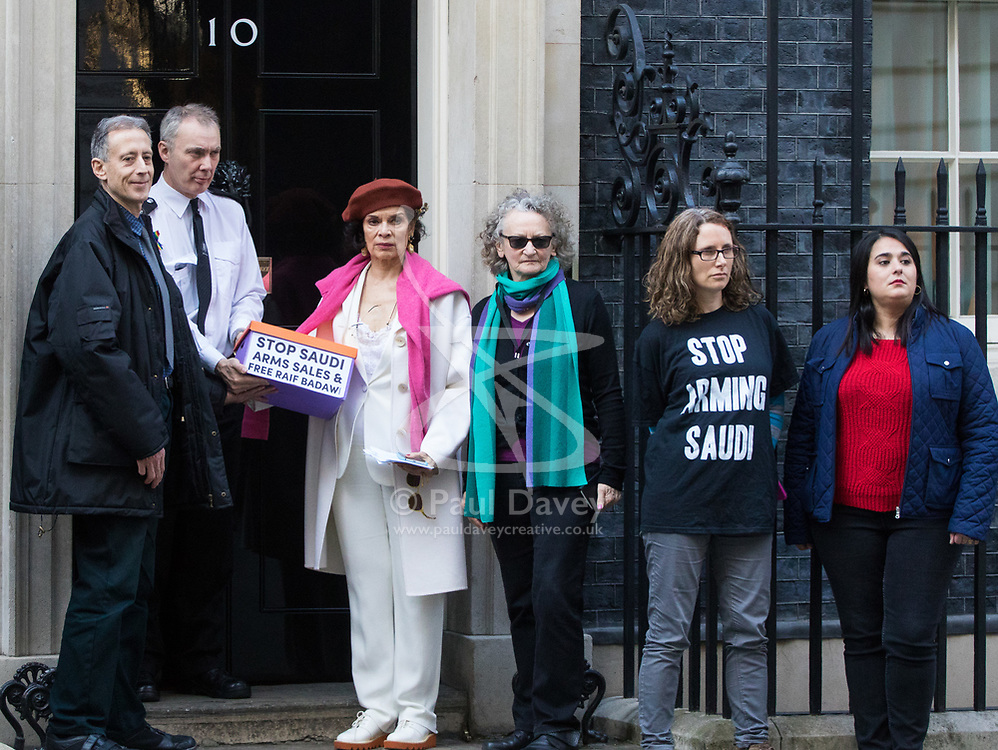 Downing Street, London, March 15th 2017. Bianca Jagger joins Bianca Jagger will join Peter Tatchell and others to hand in a 159,000-signature petition that urges the UK government to halt arms sales to Saudi Arabia over its war crimes in Yemen and its jailing of blogger Raif Badawi and other political prisoners, to Prime Minister Theresa May at 10 Downing Street. The petition is handed over to a custodian at 10 Downing Street.