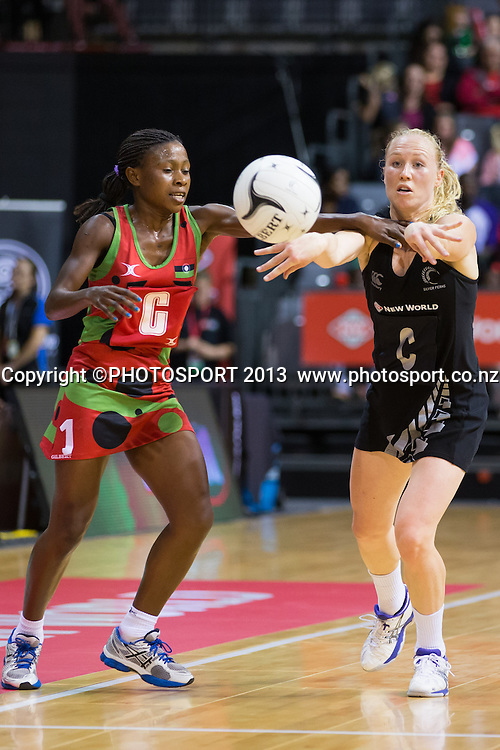 Silver Ferns Centre Laura Langman passes in front of Malawi Queens Centre Takondwa Lwazi during the New World Netball Series - Silver Ferns v Malawi, won by NZ 72-39 at Claudelands Arena, Hamilton, New Zealand, Thursday 31 October 2013. Photo: Stephen Barker/Photosport.co.nz