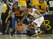 Dec 19, 2013; Long Beach, CA, USA; Southern California Trojans guard Byron Wesley (22) and Long Beach State guard Tyler Lamb (1) battle for the ball at Walter Pyramid. Long Beach State defeated USC 72-71.