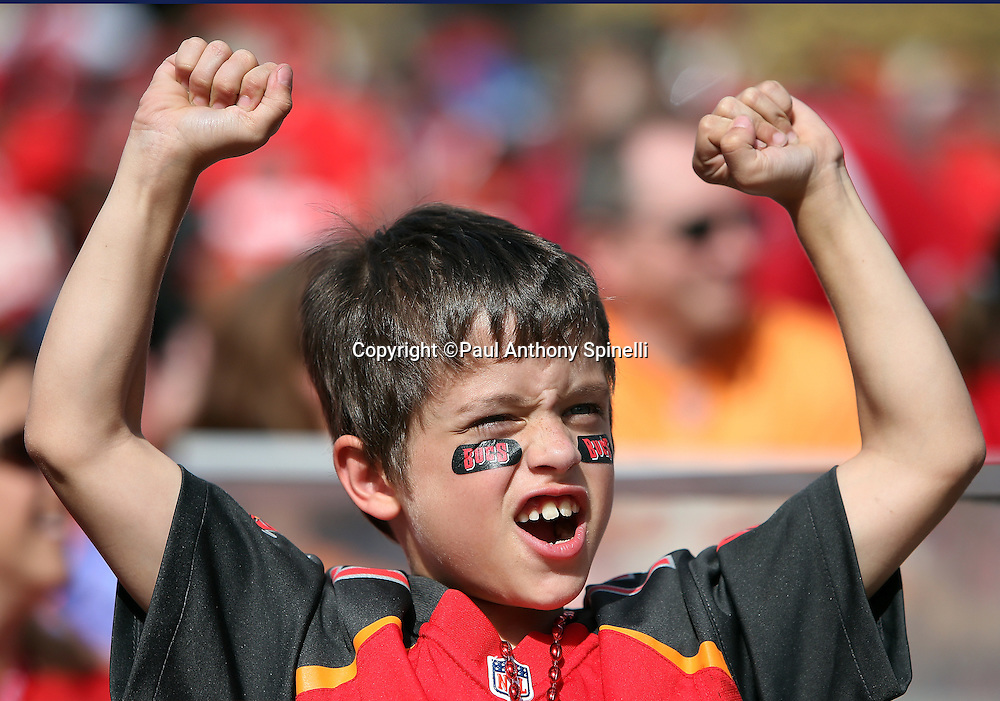 A young Tampa Bay Buccaneers fan cheers as Tampa Bay Buccaneers running back Doug Martin (22) runs for a 14 yard touchdown that cuts the New Orleans Saints second quarter lead to 14-7 during the 2015 week 14 regular season NFL football game against the New Orleans Saints on Sunday, Dec. 13, 2015 in Tampa, Fla. The Saints won the game 24-17. (©Paul Anthony Spinelli)