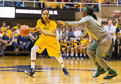Jan 30, 2016; Morgantown, WV, USA; West Virginia Mountaineers guard Jessica Morton (21) dribbles while being guarded by Baylor Bears guard Alexis Jones (30) during the first quarter at WVU Coliseum. Mandatory Credit: Ben Queen-USA TODAY Sports