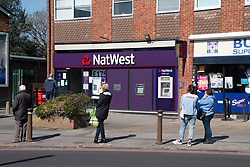 Social distancing queue outside Nat West bank during Coronavirus pandemic, Tilehurst, Reading, UK March 2020