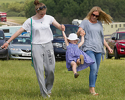 In the picture - Savannah Phillips with her mother Autumn (right).<br /> Peter Phillips the eldest grandchild of Queen Elizabeth II and Prince Philip, Duke of Edinburgh and his wife Autumn Phillips enjoyed a family day out with their children Savannah and Isla at the Barbury International Horse trials, Marlborough, Wilts.  They enjoyed the sunshine whilst watching  Zara Phillips compete in the event.<br /> Marlborough, Wilts, United Kingdom, July 06, 2013. Photo by: i-Images