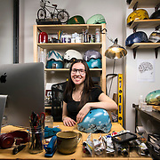 """February 24, 2014 - New York, NY : <br /> Danielle Baskin, founder of Belle Helmets, poses for a portrait in her office/studio space at 115 E. 23rd Street in Manhattan on Monday afternoon, Feb. 24. Danielle hand-paints bicycle helmets, which she sells to clients in New York and across the globe. Her setup includes a 21.5"""" iMac, visible at left, and an iPhone 5S, in foreground at right, on top of her paints in an OtterBox case.  <br /> CREDIT: Karsten Moran for Macworld Magazine"""