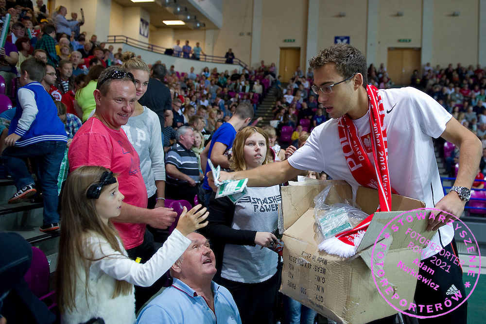 (R) Jerzy Janowicz of Poland with polish suppoters during the BNP Paribas Davis Cup 2013 between Poland and Australia at Torwar Hall in Warsaw on September 15, 2013.<br /> <br /> Poland, Warsaw, September 15, 2013<br /> <br /> Picture also available in RAW (NEF) or TIFF format on special request.<br /> <br /> For editorial use only. Any commercial or promotional use requires permission.<br /> <br /> Photo by © Adam Nurkiewicz / Mediasport