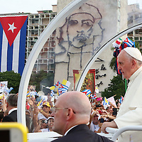 "(092015  Havana, Cuba) Pope Francis rides on the Popemobile past an image of Cuban revolutionary hero Ernesto ""Che"" Guevara and a Cuban flag as a crowd of worshippers cheers at the Plaza de la Revolucion in Havana, Sunday,  September 20, 2015.  photo by Angela Rowlings."