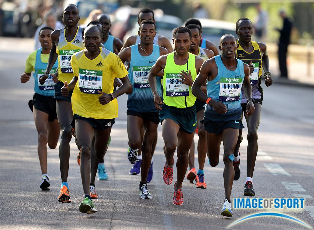 Apr 6, 2014; Paris, France; Silas Kiproto (KEN), Erick Leon Ndiema (KEN), Kenenisa Bekele (ETH), Abraham Kiplimo (UGA) and Jackson Limo (KEN) lead the Schneider Electric Marathon de Paris. Bekele won in a course record 2:05.03 in his marathon debut. Photo by Jiro Mochizuki