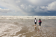 Best friends Vira Halim-Rotinsulu right) and Isabel Durham, both nine years old, observe an incoming storm at the Oregon Coast. (Fully released - 111106)