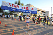 BELLVILLE, SOUTH AFRICA - Wednesday 3 December 2014, Candyce Hall crosses the line to take the ladies 3rd place during the Metropolitan 10km road race outside the Parc Du Cap head office in Bellville.<br /> Photo by IMAGE SA / Roger Sedres