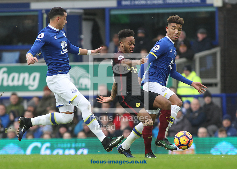Raheem Sterling of Manchester City attempts to get through the defence of Everton's Ramiro Funes Mori and Mason Holgate during the Premier League match at Goodison Park, Liverpool.<br /> Picture by Michael Sedgwick/Focus Images Ltd +44 7900 363072<br /> 15/01/2017