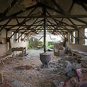 The semi-derelict bunkhouse at the former WW2 Wendling air base, Norfolk, England. Opened in 1942, it was used by both the Royal Air Force (RAF) and United States Army Air Forces (USAAF). During the war it was used primarily as a bomber airfield, being the home of the United States Army Air Forces Eighth Air Force 392nd Bombardment Group. The group flew B-24 Liberators as part of the Eighth Air Force's strategic bombing campaign. The 392d BG entered combat on 9 September 1943 and engaged primarily in bombardment of strategic objectives on the Continent until April 1945. The group attacked such targets as an oil refinery at Gelsenkirchen, a marshalling yard at Osnabrück, a railroad viaduct at Bielefeld, steel plants at Brunswick, a tank factory at Kassel, and gas works at Berlin. With the end of military control the airfield has become a turkey farm.