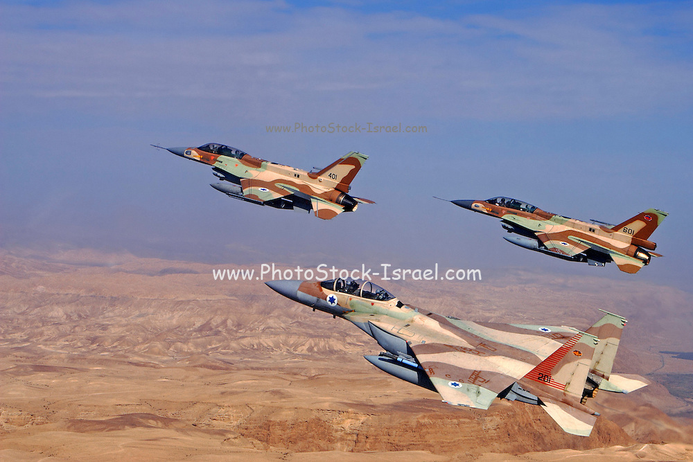 A formation of 2 F16 and one F15 Israeli Air Force fighter jets flying over the Judea mountains Dead sea area