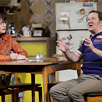 Maureen Beattie and Jonathan Watson<br /> .<br /> Yer Granny - a new production by The National Theatre of Scotland opens at the Beacon arts Centre, Greenock, Scotland.<br /> <br /> <br /> Based on La Nona by Roberto Cossa<br /> In a new version by Douglas Maxwell<br /> Directed by Graham McLaren<br /> <br /> <br /> Picture by Drew Farrell<br /> Tel : 07721-735041<br /> Image offered on a speculative basis.<br /> <br /> Yer Granny is a riotous new comedy about a diabolical 100-year-old granny who&rsquo;s literally eating her family out of house and home. She&rsquo;s already eaten their fish and chip shop into bankruptcy and now she&rsquo;s working her way through their kitchen cupboards, pushing the Russo family to desperate measures just to survive beyond 1977.<br /> <br /> As proud head of the family, Cammy is determined that The Minerva Fish Bar will rise again and that family honour will be restored &ndash; and all in time for the Queen&rsquo;s upcoming Jubilee visit. But before Cammy&rsquo;s dream can come true and before Her Maj can pop in for a chat, a single sausage and a royal seal of approval, the family members must ask themselves how far they will go to solve a problem like Yer Granny.<br /> <br /> Adapted from the smash-hit Argentinian comedy classic La Nona, the cast of Yer Granny features some of Scotland&rsquo;s best-loved performers, including Gregor Fisher in the title role, alongside Paul Riley (Still Game), Jonathan Watson (Only An Excuse?), Maureen Beattie (Casualty), Barbara Rafferty (Rab C Nesbitt), Brian Pettifer (The Musketeers) and Louise McCarthy (Mamma Mia!, West End).<br /> <br /> Performance dates :<br /> The Beacon Arts Centre, Greenock<br /> 19/05/2015&nbsp;-&nbsp;21/05/2015 <br /> <br /> King's Theatre, Glasgow<br /> 26/05/2015&nbsp;-&nbsp;30/05/2015 <br /> <br /> King's Theatre, Edinburgh<br /> 02/06/2015&nbsp;-&nbsp;06/06/2015 <br /> <br /> Eden Court, Inverness<br /> <br /> Lyric Theatre, Belfast<br /> 23/06/2015&nbsp;-&nbsp;27/06/2015 <br /> <br /> Dundee Rep Theatre<br /> 30/06/2015&nbsp;-&nbsp;04/07/2015
