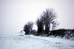30 January 2019. Pas de Calais, France.<br /> Snow falls on the hills of Hauts de France in the villages close to Montreuil Sur Mer. <br /> Photo&copy;; Charlie Varley/varleypix.com