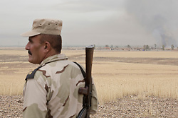 © Licensed to London News Pictures. 30/09/2015. Kirkuk, Iraq. A Kurdish peshmerga colonel is seen close to the village of Mansoria during an offensive aimed at capturing 11 villages from the Islamic State near Kirkuk, Iraq.<br /> <br /> Supported by large amounts of coalition airstrikes, members of the Iraqi-Kurdish peshmerga today (30/09/2015) took part in an offensive to take seven villages across a large front near Kirkuk, Iraq. By mid afternoon the Kurds had reached most of their objectives, but suffered around 10 casualties all to improvised explosive devices. All seven villages were originally Kurdish and settled with other ethnic groups during the Iraqi Arabisation process of the 1970's and 80's. Photo credit: Matt Cetti-Roberts/LNP