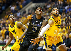 Nov 9, 2018; Morgantown, WV, USA; Buffalo Bulls forward Jeenathan Williams (11) and West Virginia Mountaineers forward Esa Ahmad (23) crash the lane for a rebound during the first half at WVU Coliseum. Mandatory Credit: Ben Queen-USA TODAY Sports