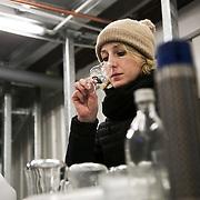 Dr Anne Brock check the quality of the latest batch of gin by sniffing it. <br /> <br /> Bermondsey Distillery, the makers of Jensen's Gin.Bermondsey Gin is established and owned by Christian Errboe Jensen. <br /> <br /> Bermondsey Distillery, kendt for deres Jensen's Gin, startet og ejet af danskeren  Christian Jensen.  Dr. Anne Brock checker qualiteten ved at lugte til hver eneste destillering inden den sendes videre for at komme på flaske.
