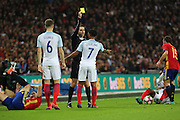 England attacker Raheem Sterling (07) receives a yellow card during the Friendly match between England and Spain at Wembley Stadium, London, England on 15 November 2016. Photo by Matthew Redman.