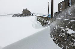 © London News Pictures. 23/03/2013 . Blizzards cause huge snow drifts in Hadfield, Derbyshire. The UK has been hit by heavy snow and flood alerts. Photo credit: Duncan Fawkes/LNP