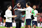 Liverpool manager Jurgen Klopp celebrates the 3-0 win with Virgil van Dijk (4) of Liverpool at full time during the Premier League match between Bournemouth and Liverpool at the Vitality Stadium, Bournemouth, England on 7 December 2019.