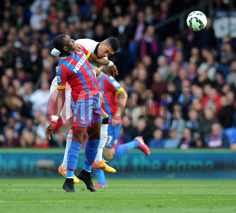 Crystal Palace's Yannick Bolasie battles for a high ball with Manchester United's Chris Smalling - Photo mandatory by-line: Alex James/JMP - Mobile: 07966 386802 - 09/05/2015 - SPORT - Football - London - Selhurst Park - Crystal Palace v Manchester United - Barclays Premier League
