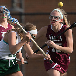 Nerinx Hall's Erin Salsich (11) drove downfield in the last minutes of the sconde half of a game between Nerinx Hall High School and Villa Duchesne at Nerinx Hall in Webster Groves April 5, 2016. Villa Duchesne won 9-8. Teak Phillips | St. Louis Review