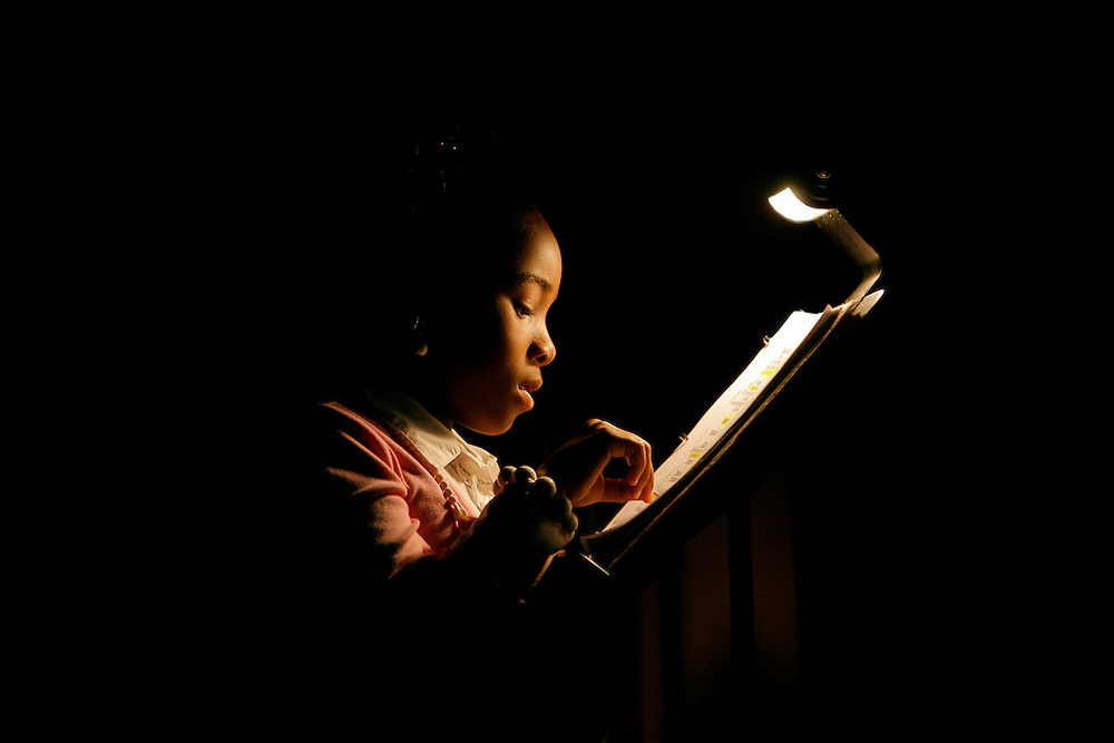 "(02/24/2008) In the wings of the stage young Le'Asia Tullis, 8 reads over the list of performers during The Black History Pageant's 30th Annual Production ""Lest We forget: A Tribut to Reverend Peggy Peterman & African American Journalist"" at the Mahaffey Theater on Sunday evening.  The cast of young performers used a variety of creative ways to share the history of African Americans in journalism like  poetry, praise dancing, Step Dancers, singers and reading in this years production. (Willie J. Allen Jr. 