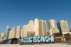 View of beach and high rise apartment building at The Beach in Jumeirah Beach  district of modern Dubai, UAE, United Arab Emirates.