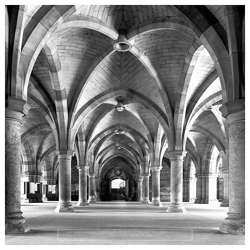 Black and white image of The Cloisters, University of Glasgow, looking toward Bute Hall.