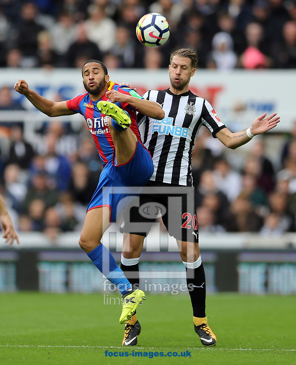 Florian Lejeune (r) of Newcastle United and Andros Townsend of Crystal Palace during the Premier League match at St. James's Park, Newcastle<br /> Picture by Simon Moore/Focus Images Ltd 07807 671782<br /> 21/10/2017