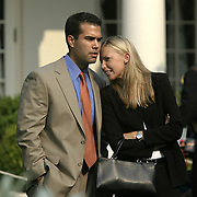 George P. Bush, the nephew of the president, talks with an unidentified woman in the Rose Garden of the White House Friday, June 27, 2003.  According to the Secret Service, she is George P. Bush's current girlfriend...Photo by Khue Bui