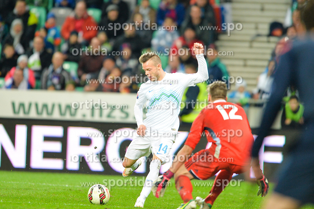Lazarevic Dejan of Slovenia vs  Benedettini Elia of San Marino during football match between NationalTeams of Slovenia and San Marino in Round 5 of EURO 2016 Qualifications, on March 27, 2015 in SRC Stozice, Ljubljana, Slovenia. Photo by Mario Horvat / Sportida