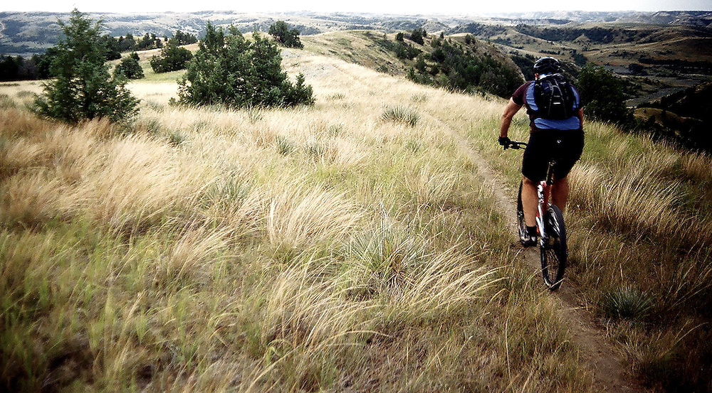 A cyclist descends along epic singletrack on the Maah Daah Hey trail in North Dakota.