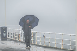 © Licensed to London News Pictures. 20/12/2017. Aberystwyth, Wales, UK. The sea front on a misty and foggy day in Aberystwyth, with low visibility making for challenging driving conditions in the town and on the surrounding roads. Photo credit: Keith Morris/LNP